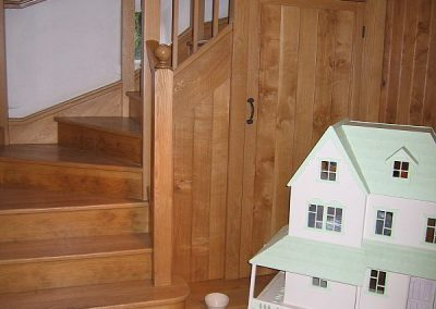 staircase with under stair door